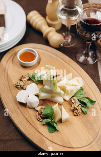 Appetizers with sauce on table - Stock-Bilder