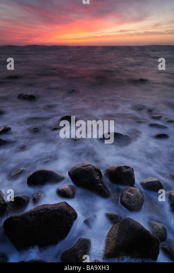 Stones in moving water Halland Sweden - Stock Image