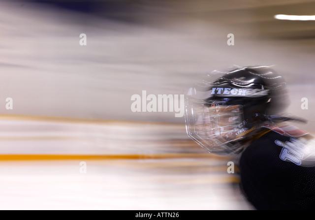 Blurred boy playing hockey - Stock Image