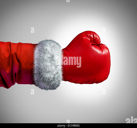 Santa clause boxing glove concept as a holiday business concept for competing consumer shopping after christmas - Stock Image