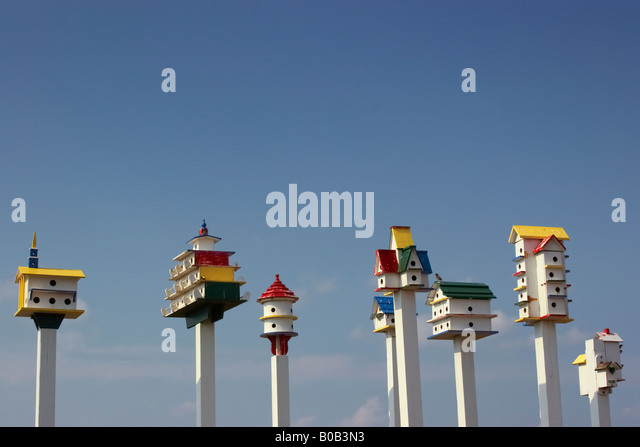 Colorful painted birdhouses in the front yard of a property on Rt 12 Southern Shores North Carolina - Stock Image