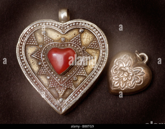 Two silver jewellery heart pendant lockets - Stock Image