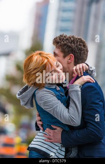 Couple hugging, Toronto, Ontario, Canada - Stock Image