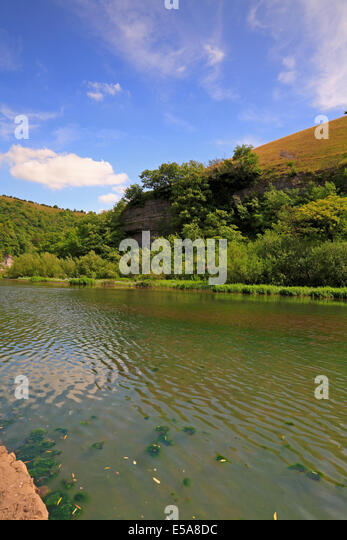 River Wye through Water-cum-Jolly Dale on the Monsal Trail, Derbyshire, Peak District National Park, England, UK. - Stock Image