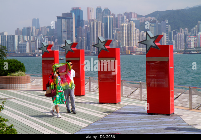 Hong Kong China Kowloon Tsim Sha Tsui Avenue of the Stars Victoria Harbour harbor waterfront promenade Asian woman - Stock Image