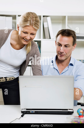 Closeup on two colleagues - Stock Image