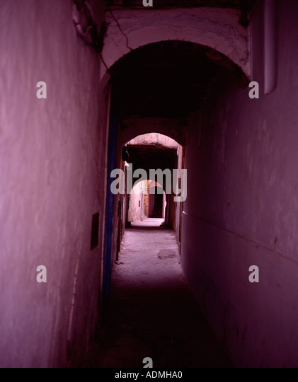 Pink street through archway medina Essaouira Morocco - Stock Image