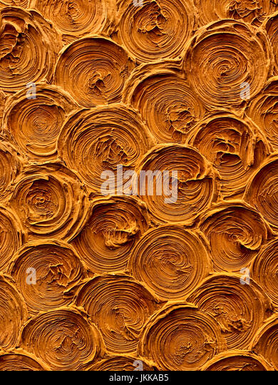 circular shell spiral background pattern texture on the earthen wall surface, detail backdrop design closeup abstract - Stock Image