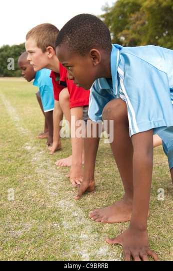 Three boys line up to run race, Johannesburg, Gauteng Province, South Africa - Stock Image