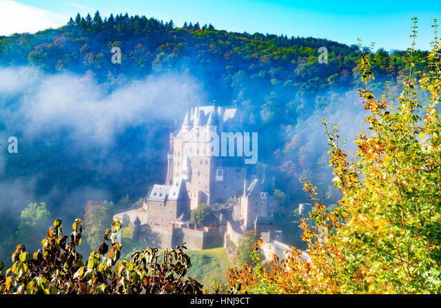 Eltz Castle and morning fog, Moselle River, Rhineland, Germany 12th Century Castle - Stock-Bilder
