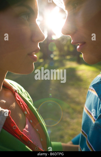 Couple in love about to kiss in the sunlight. - Stock-Bilder
