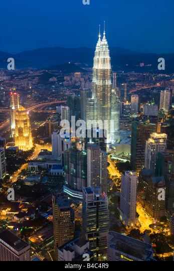 Asia, Malaysia, Selangor State, Kuala Lumpur, elevated view of iconic 88 storey steel clad Petronas Towers and KL - Stock Image