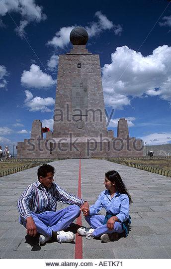 Ecuador Quito Monumento a la Mitad del Mundo Hispanic couple red line is equator monument - Stock Image