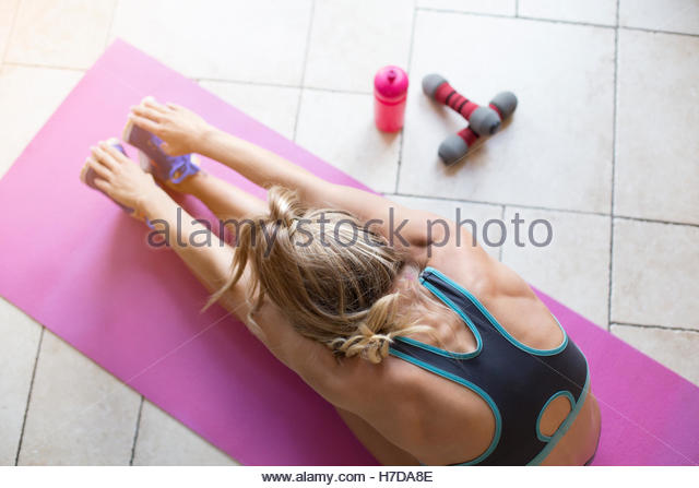 Post-Workout stretches at home - Stock Image