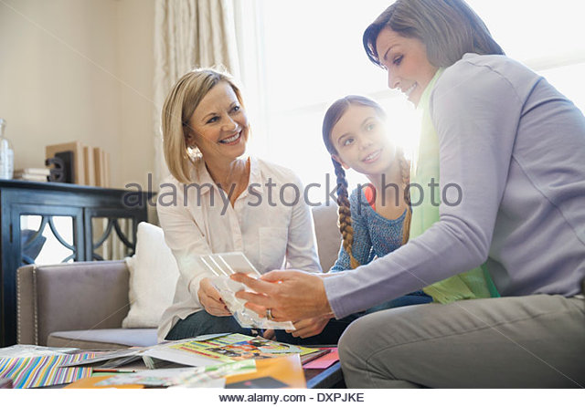 Women scrapbooking at home - Stock Image