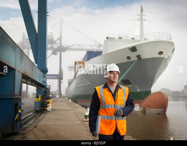 Port Worker With Container Ship - Stock-Bilder