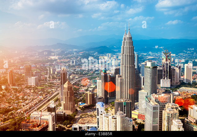 Kuala Lumpur skyline with the Petronas Towers and other skyscrapers. - Stock Image