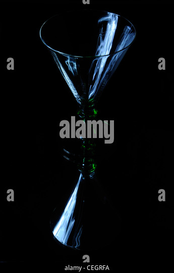 Art Deco cocktail glass and its reflection - Stock Image