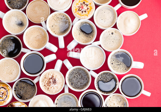Coffee mecca with multiple assorted types and flavors of coffee in identical white mugs artistically arranged with - Stock-Bilder
