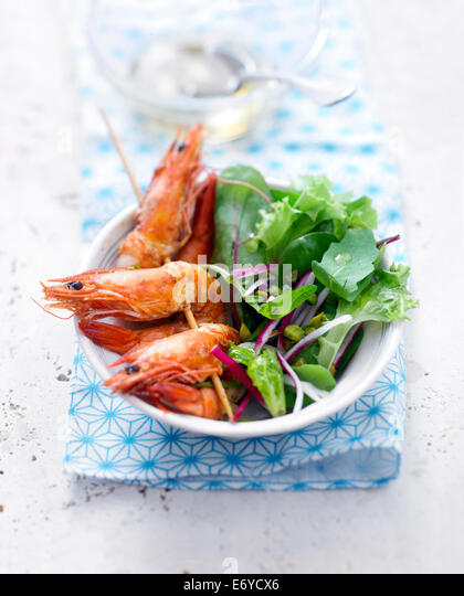 Gambas brochettes ,radish salad with pistachio oil - Stock-Bilder