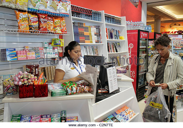 Cancun Mexico Yucatán Peninsula Quintana Roo Cancun International Airport Hispanic woman shopping sundries - Stock Image