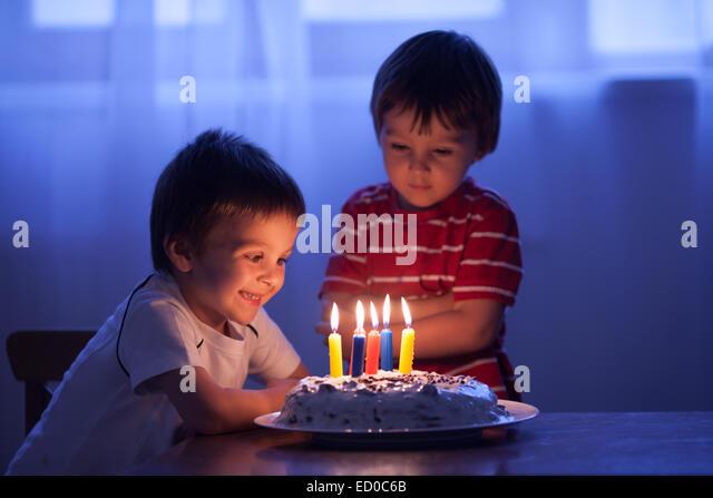 Boy (4-5) celebrating birthday - Stock Image