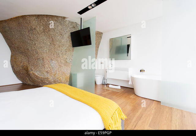 Sliding glass door of modern en suite bathroom - Stock Image