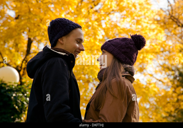 Young couple face to face in autumn park, Vienna, Austria - Stock Image