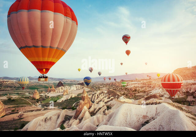 Turkey Cappadocia beautiful balloons flight stone landscape - Stock Image