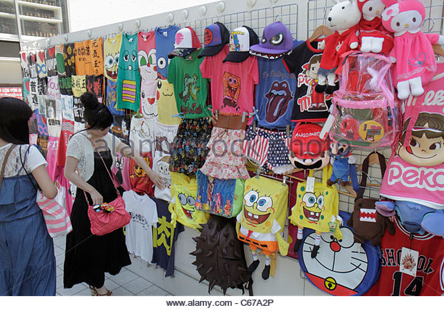 Japan Tokyo Harajuku Takeshita Dori Street Asian teen girl shopping - Stock Image