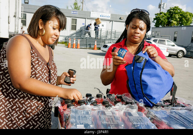 Miami Florida Little Haiti Thanksgiving Turkey Give-Away give away volunteers Black Haitian woman women packing - Stock Image