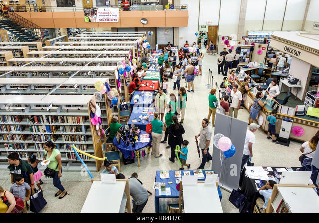 Florida Miami Hialeah JFK Library Health and Literacy Fair interior exhibitors tables - Stock Image