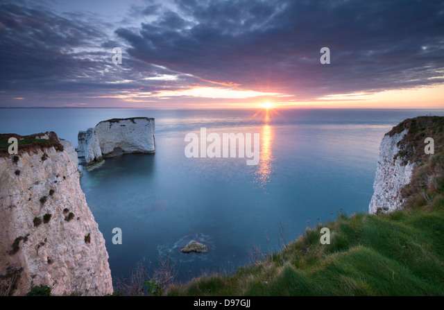 Sunrise over Old Harry Rocks, Jurassic Coast, Dorset, England. Spring (April) 2012. - Stock Image