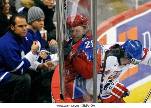 Russia's Nikita Filatov (C) collides with Czech Republic's Tomas Kundratek (R) during the second period - Stock Image