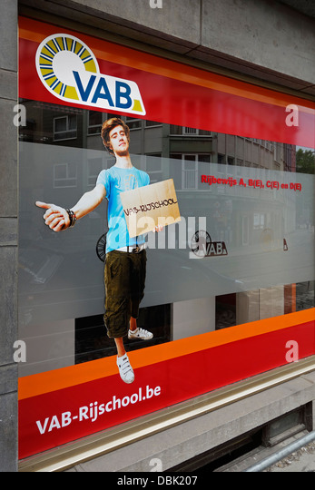Sign in shop window of Flemish driving school VAB where you can obtain a Belgian car driver's license after - Stock Image