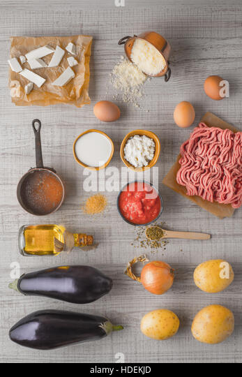 Ingredients for moussaka on the white table  vertical - Stock Image