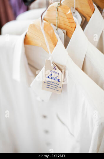 Items for sale at Laha, a 2-floor textile shop in front of National Museum. Luang Prabang,Laos - Stock Image