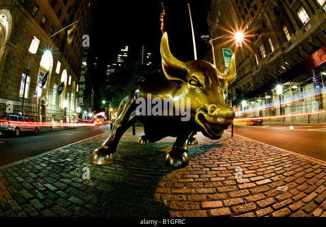 The Wall Street Bull at night - Stock Image