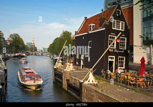 Amsterdam historic building 1695 draw bridge Cafe de Slyswacht Canal boat background Oude Schans Motelbaans Toren - Stock Image