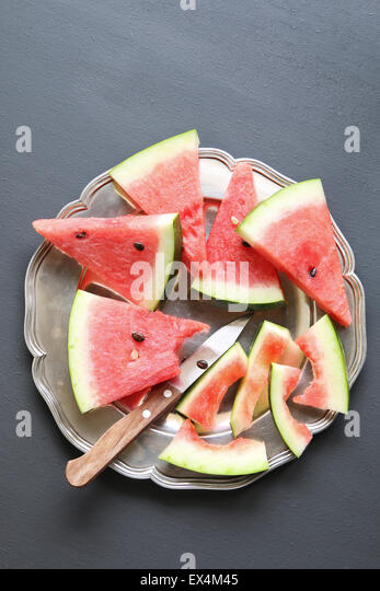 Slices of watermelon on a plate - Stock Image