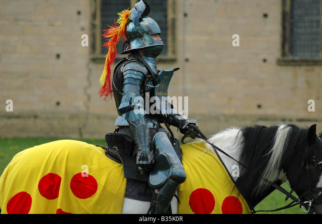 Knight in armour mounted on horse - Stock Image
