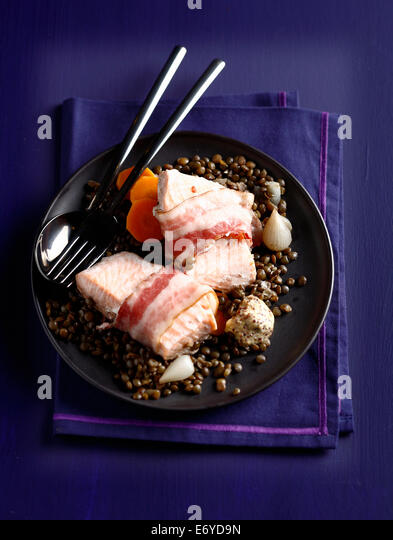 Salmon with salt pork and lentils - Stock Image