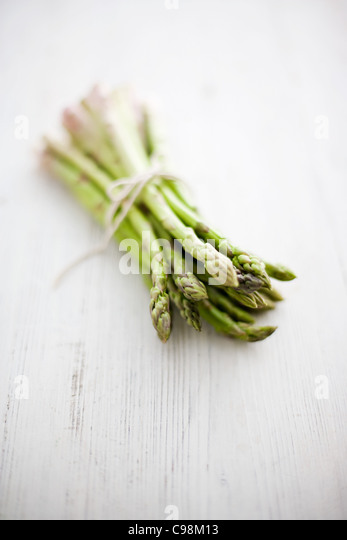Fresh asparagus tied with string - Stock Image