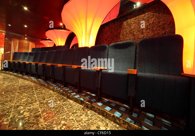 illuminated hall inside of ship. row of comfortable seats. wide angle. - Stock Image