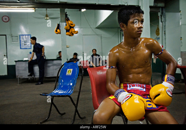 Thai kick boxer resting for his fight, Bangkok Thailand - Stock Image
