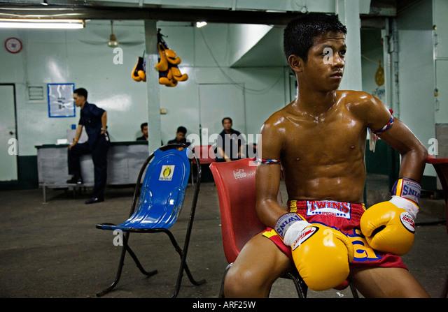 Thai kick boxer resting for his fight, Bangkok Thailand - Stock Image
