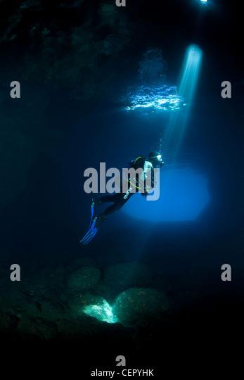 Scuba Diver Silhouette in Green Cave, Vis Island, Adriatic Sea, Croatia - Stock Image