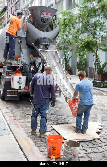 New York New York City NYC Lower Manhattan SOHO street scene concrete mixer cement truck construction worker laborer - Stock Image