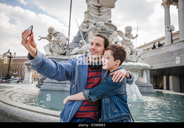 Young adult couple taking picture of themselves, Vienna, Austria - Stock Image