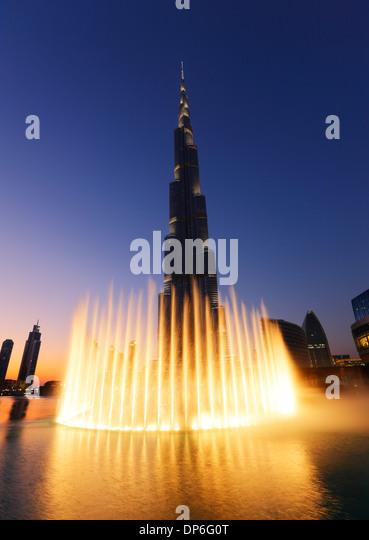 Dubai, Burj Khalifa and illuminated fountain. - Stock Image